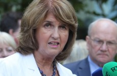 Protesters block Joan Burton's car from leaving Dublin event