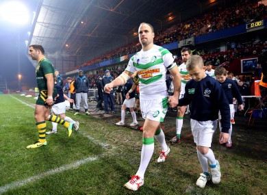 Liam Finn leads out the Ireland team against Australia in the Rugby World Cup last year.