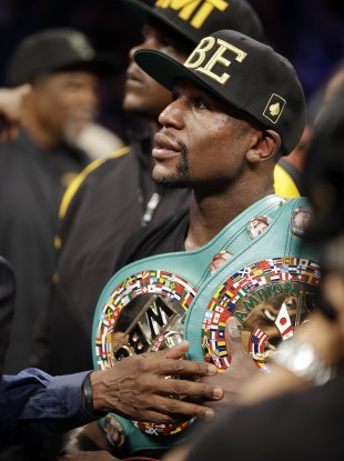 Mayweather retained his welterweight and light-middleweight titles with the 47th straight win of his unbeaten career.