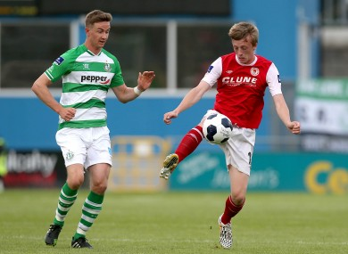 Chris Forrester of St Patrick's Athletic in possession with Shamrock Rovers midfielder Ronan Finn.