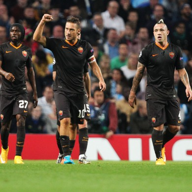 Totti and the Roma players celebrate.