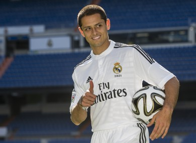 Mexico's international soccer player Javier Hernandez 'Chicharito', poses during his official presentation at the Santiago Bernabeu stadium in Madrid.