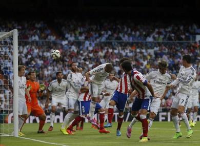 Atletico Madrid's Tiago, centre right, scores a goal during a Spanish La Liga.