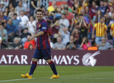 Barcelona's Lionel Messi from Argentina smiles during a Spanish La Liga soccer match between F.C. Barcelona and Granada C.F. at the Camp Nou stadium.
