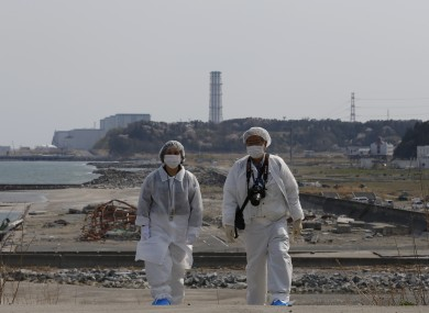 Two people tour the site of the Fukushima nuclear disaster in Japan.