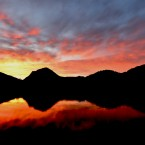 A fire glow at sunrise over Buttermere in the Lake District.