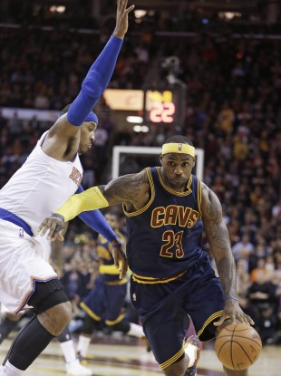 Cleveland Cavaliers' LeBron James  drives against New York Knicks' Carmelo Anthony.