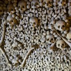 Skulls and bones are stacked at the Catacombs in Paris, France. As if visiting the Paris Catacombs in the daytime weren't creepy enough _ soon you can visit the underground maze of skeletons at night, too. The subterranean tunnels, which once gave refuge to smugglers and saints, cradle the bones of some 6 million Parisians from centuries past. (AP Photo/Francois Mori)<span class=
