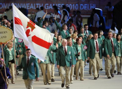 Northern Ireland team carry their flag at the Commonwealth Games.
