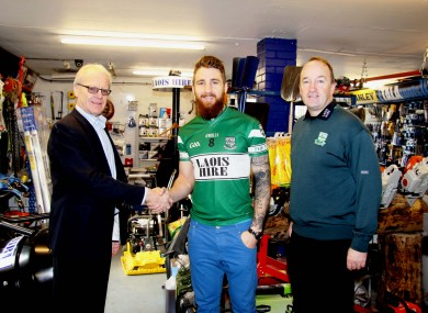 Michael Killeen, M.D. Laois Hire, with Portlaoise's Zach Tuohy and Club Officer, John Hanniffy.