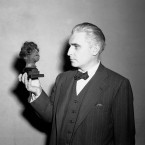 Thomas Dodd, assistant U.S. prosecuting attorney at the International Military Tribunal at Nuremberg, Germany, holds a human shrunken head, that he introduced as evidence of cruelty in German concentration camps during the unprecedented trial. <span class=