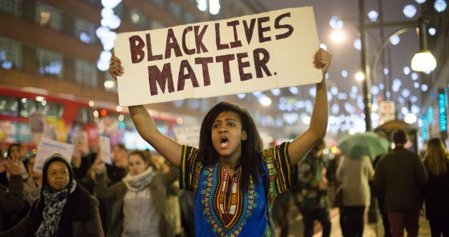 Streets of Ferguson calmer after three days of protests over teen's shooting