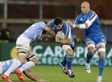 Argentina's Leonardo Senatore, left, competes for the ball with Italy's Quintin Geldenhuys.