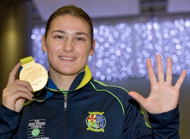 Katie Taylor returned home to Dublin Airport this evening with a fifth world championship gold medal.