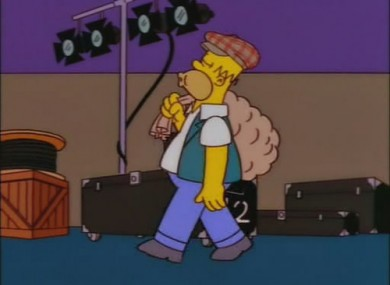 Homer Simpson goes in disguise as the 'potato man' to get backstage at a U2 gig.