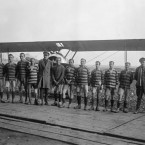 The Royal Flying Corp football team of No.54 Squadron RAF line up in front of a Sopwith Camel aircraft.<span class=