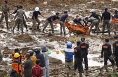 Rescuers dig through mud after Indonesian landslide kills 8 people