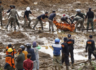 Rescuers move body found in the mud