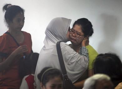 Relatives wait for news at Juanda International Airport