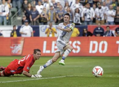 Robbie Keane with the winner.