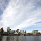 The Portland skyline is visible on the bank of the Willamette River in Portland, Oregan. The White House is singling out 16 U.S. cities, including Portland, for leading their peers in efforts to address climate change.(AP Photo/Don Ryan)<span class=