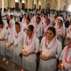 Pakistani Christians take part in a prayers ceremony for victims killed in Tuesday's Taliban attack on a military-run school in Peshawar, at St. Patrick Cathedral in Karachi, Pakistan.<span class=