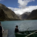 Tourists guides wait for customers in the Chinamacocha lake in the Huascaran National Park in Huaraz, Peru. The Yanapaccha glacier is seen the the background. Glaciers have lost more one-fifth of their mass in just three decades, and the 70 percent Peru's 30 million people who inhabit the country's Pacific coastal desert, depend on glacial runoff for hydropower and to irrigate crops, meaning their electricity and long-term food security could also be in peril. (AP Photo/Rodrigo Abd)<span class=