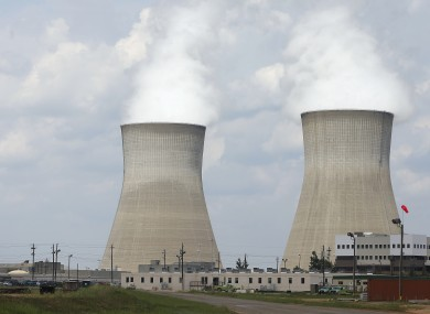 The cooling towers, right, and nuclear reactor containment buildings, left, at Plant Vogtle Nuclear Power Plant are shown in Waynesboro, Georgia.