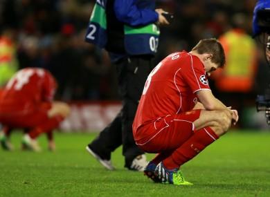 Steven Gerrard dejected after Liverpool crash out.