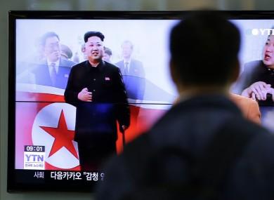 A man watches a TV news program showing North Korean leader Kim Jong Un.