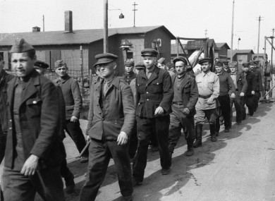 Russian prisoners of war leave their stalag (prison camp) in March 1945 after the camp was liberated.