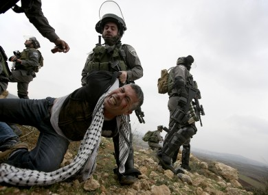 Israeli border police detaining a Palestinian protester earlier this month
