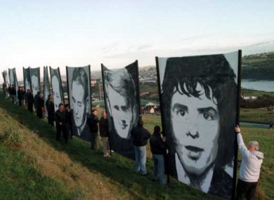 Pictures of the Bloody Sunday victims being carried into Derry city, 1997.