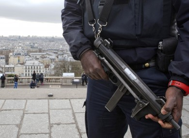 A French police officer patrols around the Sacre Coeur basilica in the Paris Montmartre district.