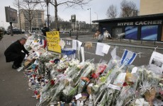 The Charlie Hebdo offices are still surrounded by tributes to slain journalists