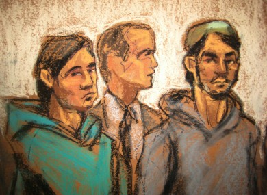 In this courtroom drawing, defendant Akhror Saidakmetov, left; an interpreter, center; and defendant Abdurasul Hasanovich Juraboev