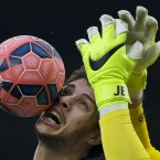 Blackburn's Rudy Gestede, left, in action against Stoke's goalkeeper Jack Butland during the English FA Cup fifth round soccer match between Blackburn and Stoke at Ewood Park Stadium, Blackburn, England. (AP Photo/Jon Super)<span class=