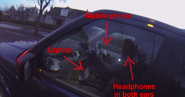 Video shows driver using phone and wearing headphones … with his laptop open