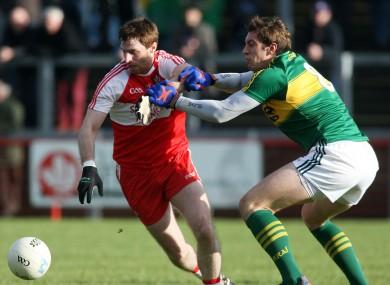 Derry's Gerard O'Kane and Kerry's David Moran.