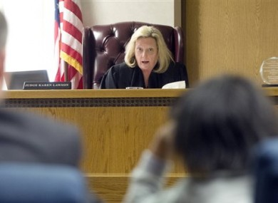 Lake County Juvenile Court Judge Karen Lawson, back, tells the 11-year-old girl her rights.