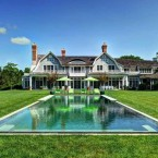 On 2.2 acres of well-manicured lawns sits this eight-bedroom mansion with six fireplaces, a butler's pantry, library, tennis court, and heated pool.  It has 9,000 square feet of space and was built in 2010 with the latest appliances and electronics.