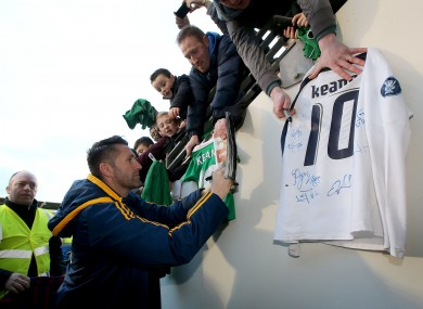 Kean signing jerseys after yesterday's training session.
