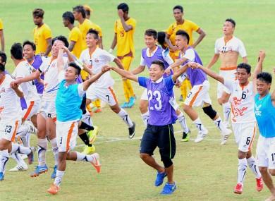 Bhutan's national team celebrate against Sri Lanka.