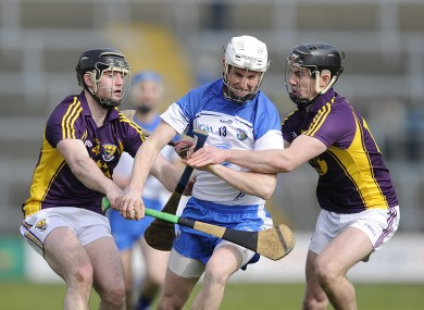 Waterford's Brian Halloran in action against Wexford's Eoin Moore and Eoin Conroy.