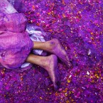 A Hindu widow lies on a sludgy ground filled with a mixture of colored powder, water and flower petals during celebrations to mark Holi, the Hindu festival of colors, at the Meera Sahabhagini Widow Ashram in Vrindavan, India. After their husband's deaths many of the women in the ashrams have been banished by their families, for supposedly bringing bad luck, while some move voluntarily to and around the town where devotees believe Lord Krishna was born. (AP Photo/Bernat Armangue)<span class=