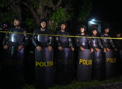Indonesian police line up in front of a prison during the transfer of Australian death row prisoners, Andrew Chan and Myuran Sukumaran in Bali.