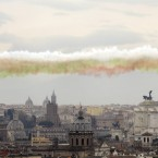 Smoke trails in the colors of the Italian national flag are released by The 'Frecce Tricolori' Italian Air Force acrobatic squad as they flew over Rome, to mark the 154th anniversary of the Italian Unification in 1861. (AP Photo/Gregorio Borgia)<span class=