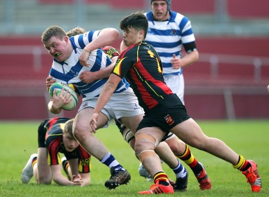 Rockwell's Niall Campion with Ty Chan of Ardscoil Rís.