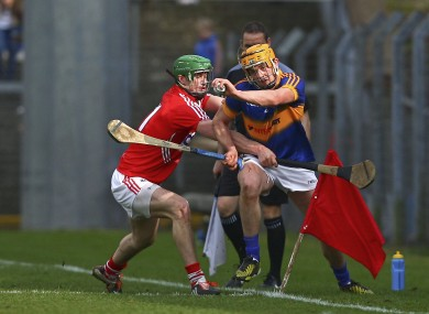 Cork's Seamus Harnedy and Tipperary's Ronan Maher challenging today.