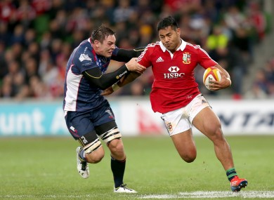 Gareth Delve tries to tackle Manu Tuilagi during the last Lions tour.